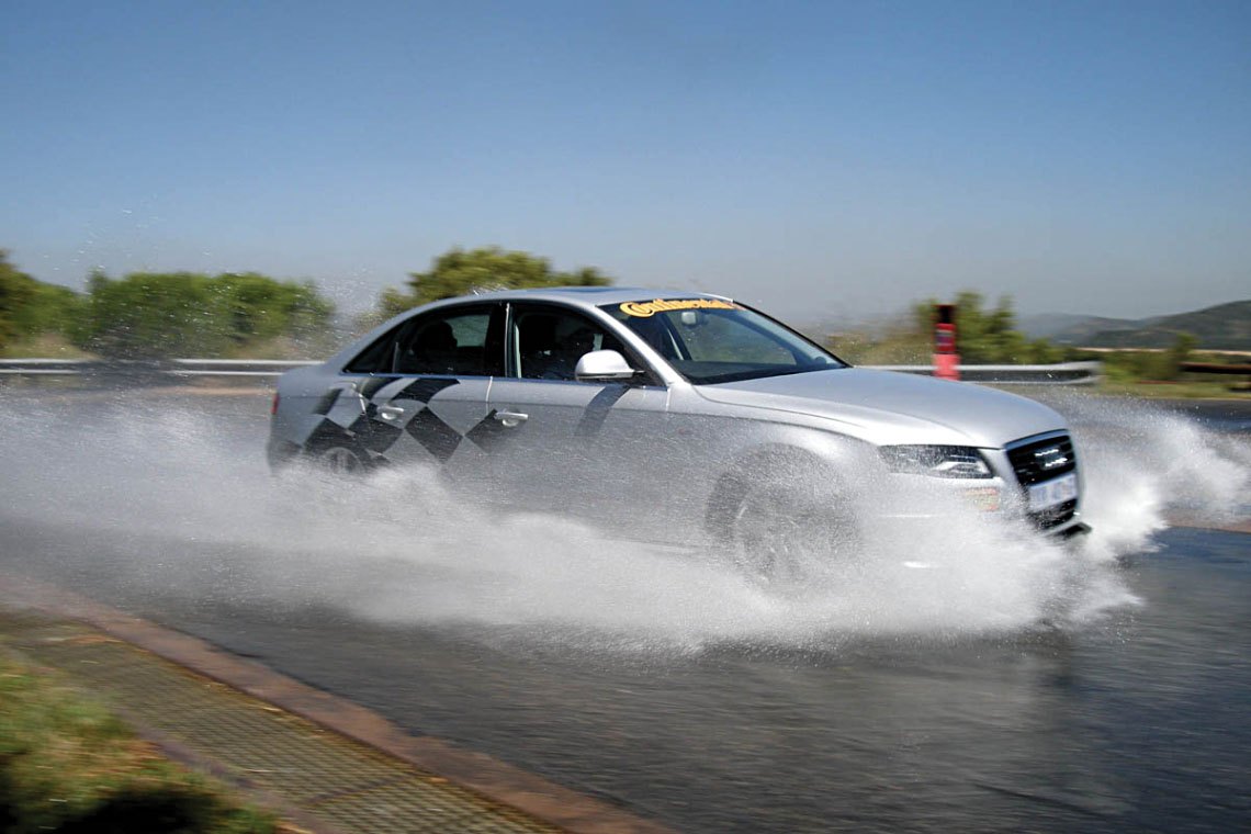 silver audi in skid control advanced driving